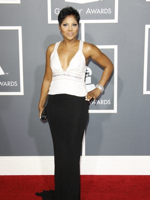 Toni Braxton arrives at the 2011 Grammy Awards at the Staples Center in Los Angeles.