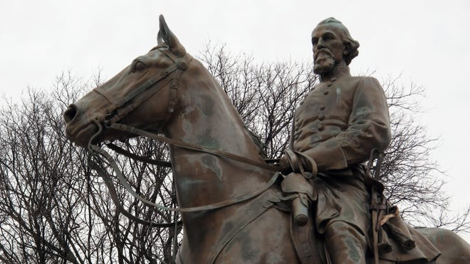A statue of Nathan Bedford Forrest sits on a concrete pedestal at a park named after the confederate cavalryman in Memphis, Tenn.