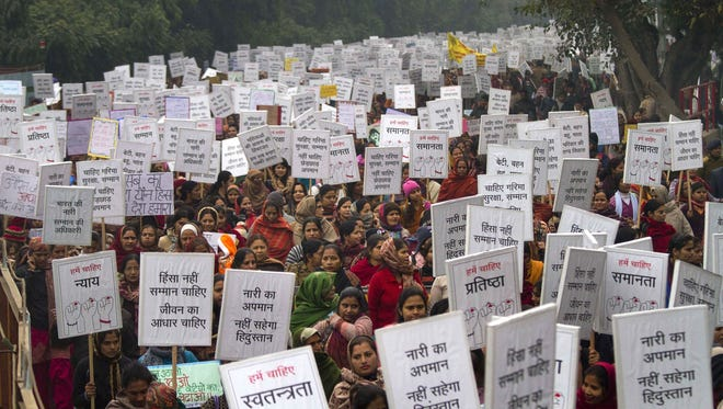 Indian women carry placards as they march to mourn the death of a gang rape victim in New Delhi.