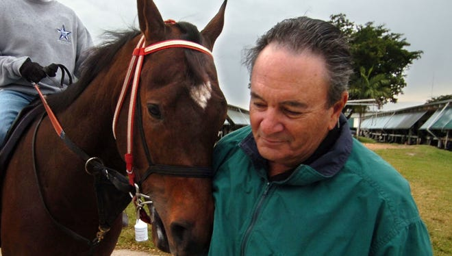 Trainer Eddie Plesa Jr. in a 2010 photo with his horse, Value Added Tax, at Calder Race Course in Miami. Plesa is eyeing the Kentucky Derby for the second time in his long career with Itsmyluckyday.