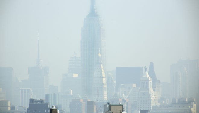 Smog covers midtown Manhattan in New York in this July 10, 2007, photo.