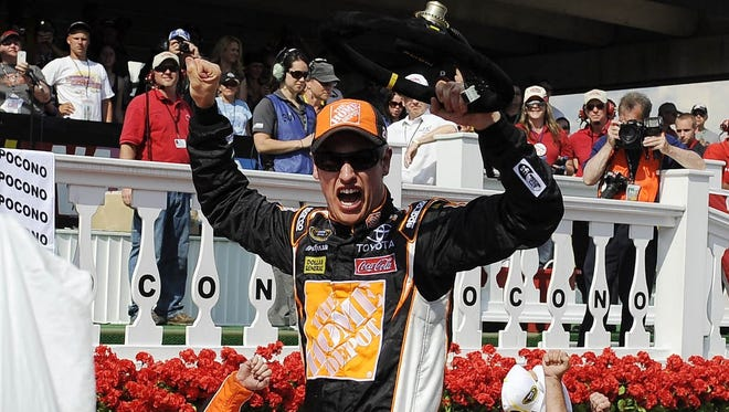 Joey Logano celebrates after winning the Pocono 400 at Pocono Raceway last June.