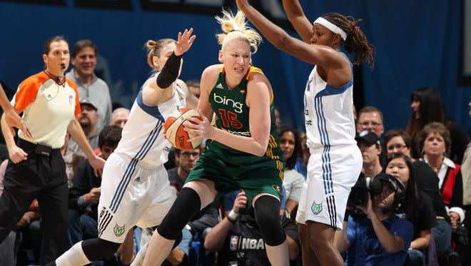 Lauren Jackson, center, getting double-teamed by Lynx guard Lindsay Whalen, left, and forward Rebekkah Brunson during a Sept. 2012 game, will skip the 2013 season to fully recover from injuries that have taken a toll on the three-time MVP.