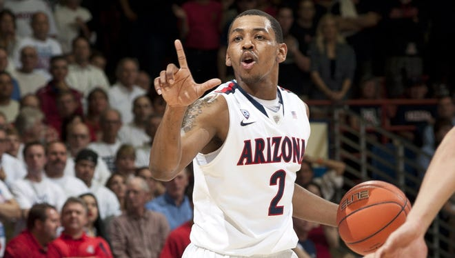 Arizona Wildcats guard Mark Lyons signals to his teammates during the second half against the Stanford Cardinals at McKale Center.