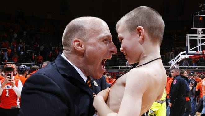 Illinois coach John Groce hugs his son Conner after the Illini upset No. 1 Hoosiers 74-72 on Thursday at Assembly Hall in Champaign, Ill.