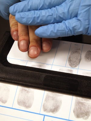 Florida requires applicants for its concealed-carry weapons permits to submit their fingerprints, a process that costs applicants about $35.