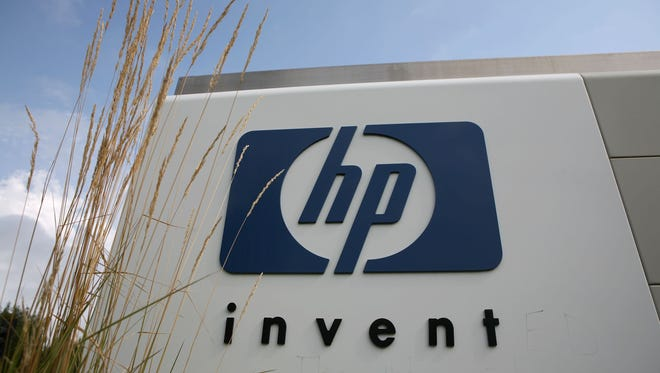 The HP logo is displayed on the entrance to the Hewlett-Packard headquarters in Palo Alto, Calif.