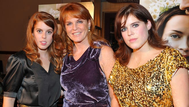 Princess Beatrice, Sarah Ferguson Duchess of York, and Princess Eugenie in 2009.
