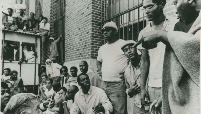 Elliot Barkley (second from right), spokesman for Attica prisoners during the talks with New York State Commissioner on Corrections Russell Oswald as the  September 1971  uprising by prisoners entered its second day.