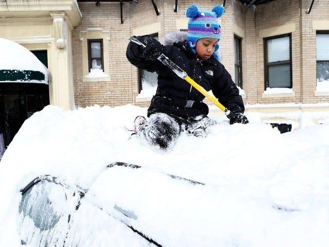 Boston enjoys playing in snow as area recovers
