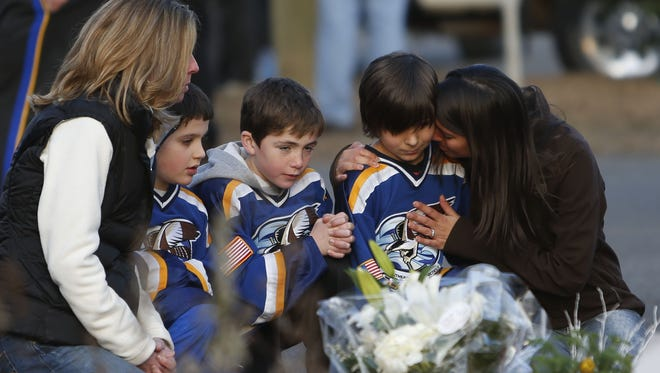 There's some debate among experts about whether kids who experience traumatic events like Sandy Hook school shootings in Newtown, Conn.  need to be treated differently than those who are abused.