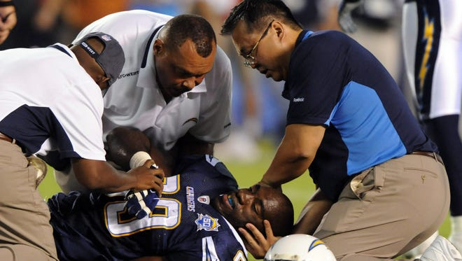 David Chao, right, says he performed 204 surgeries on Chargers players in 10 seasons.