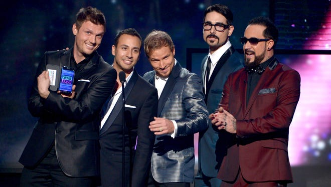 The Backstreet Boys speak during the 40th American Music Awards. They will be the subject of an upcoming documentary.