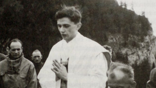 Joseph Ratzinger, who later became Pope Benedict XVI, celebrates Mass at a mountain site near the Bavarian town of Ruhpolding, Germany, in the summer of 1952.