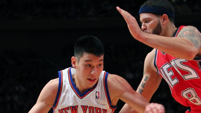 New York Knicks guard Jeremy Lin (17) drives to the basket against New Jersey Nets guard Deron Williams (8) on Feb. 4, 2012, the night Linsanity began.