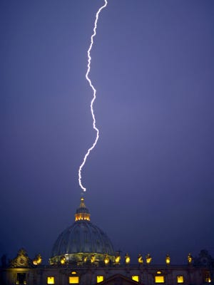 Lightning strikes St Peter's dome at the Vatican on Monday.