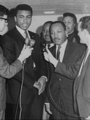Heavyweight champion Muhammad Ali, left, alongside Dr. Martin Luther King Jr., fought being drafted into military service in 1967 because of his religious beliefs. King later said the sooner the country did away with the draft, the better off Americans would be.