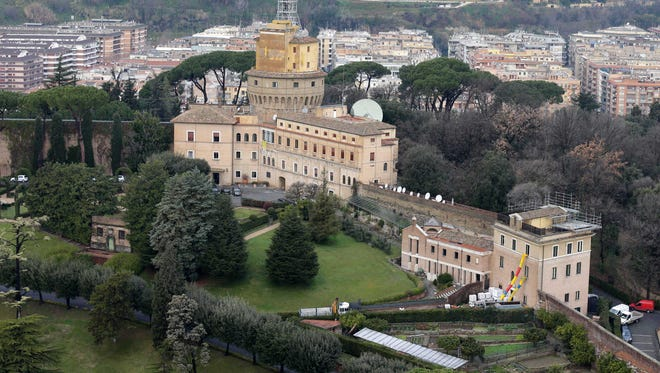 Mater Ecclesiae Monastery, right, next to the Tower of San Giovanni, inside the Vatican State is where Pope Benedict XVI is expected to settle shortly after he resigns Feb. 28.
