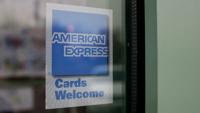 A sign showing the American Express logo is seen outside of a restaurant in Des Plaines, Ill..