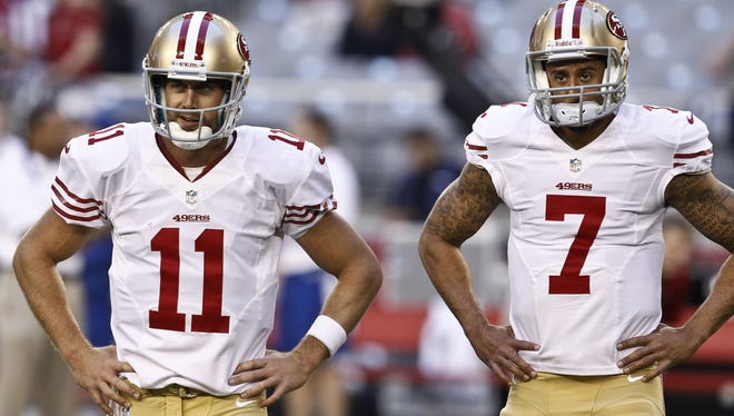 Alex Smith and Colin Kaepernick (7) shared starting duties in San Francisco in 2012, and both made USA TODAY Sports' All-Joe team.