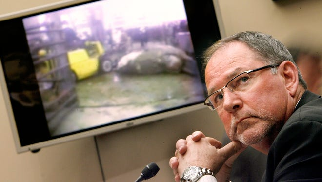 """In this file photo from March 8, 2008, Steven Mendell, then chief executive of Westland/Hallmark Meat Co. of Chino, Calif., watches a video of """"downer"""" cattle at his slaughterhouse while he testifies before the House Energy and Commerce Committee in Washington. An undercover Humane Society of the United States representative posing as an employee at the slaughterhouse shot the video, which prompted the largest ground beef recall in U.S. history. The company is now bankrupt."""