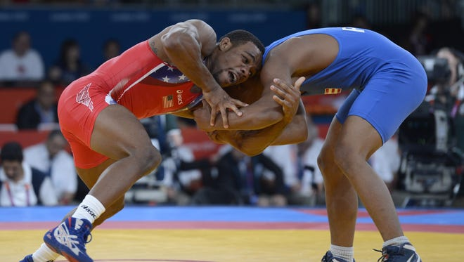 Jordan Burroughs, left, will take on Iranians, Russians and more at the 2013 Freestyle World Cup in Tehran next week.