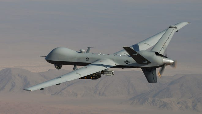 This undated handout photo provided by the U.S. Air Force shows a MQ-9 Reaper, armed with GBU-12 Paveway II laser guided munitions and AGM-114 Hellfire missiles, piloted by Col. Lex Turner during a combat mission over southern Afghanistan.