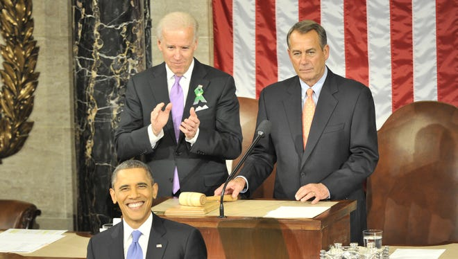 President Obama gets ready to deliver his 2013 State of the Union Address as Vice President Biden and House Speaker John Boehner look on.