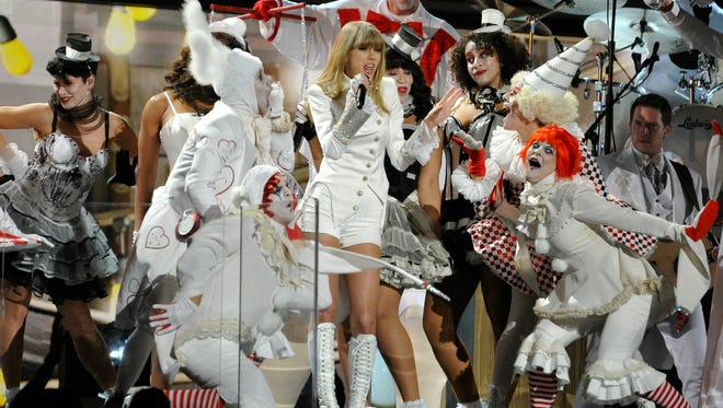 Taylor Swift opened the 2013 Grammy Awards Show with ?'We Are Never Getting Back Together?.'