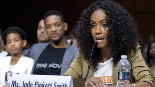 "Jada Pinkett Smith, right, accompanied by her actor husband Will Smith, and their daughter Willow Camille Reign Smith, left, testifies before the Senate Foreign Relations Committee during a hearing on ""The Next Ten Years in the Fight Against Human Trafficking: Attacking the Problem with the Right Tools"" on Capitol Hill in Washington."