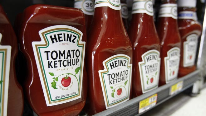 Bottles of Heinz ketchup are displayed at a grocery store in Palo Alto, Calif.