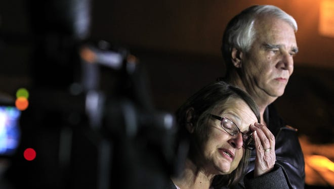 Jim Reynolds, right, and wife, Karen Reynolds recount their experience in Big Bear Lake, Calif., as captives of Christopher Dorner.