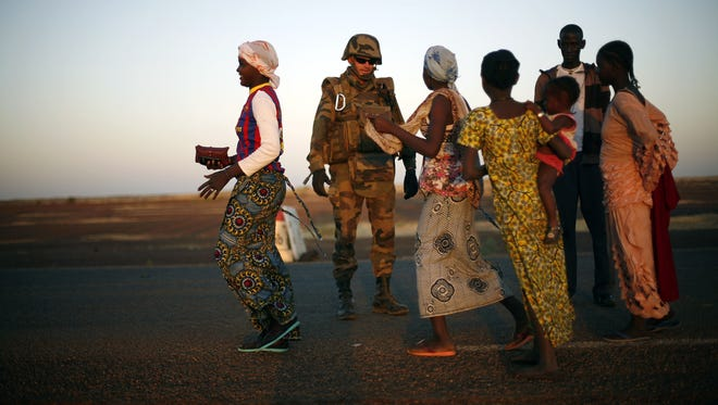 A French soldier checks female passengers of a transport truck arriving in Gao, northern Mali, on Thursday.