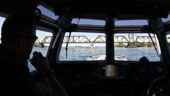 Border patrol agents monitor a freight train entering from Canada on the International Railroad Bridge in Buffalo, N.Y.