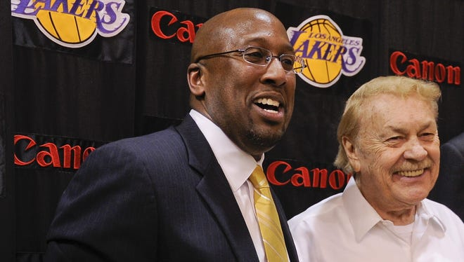 Jerry Buss, right, was on hand for the news conference introducing Mike Brown as the Lakers coach in May 2011. The love affair didn't last long, as Brown was fired early in the 2012-13 season.