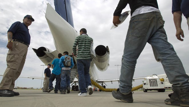 Deportees are escorted to a private plane to Mexico City.