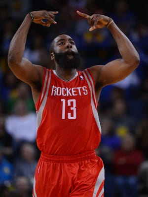 Houston Rockets shooting guard James Harden (13), shown here celebrating after making a three-point basket against the Golden State Warriors on Tuesday, has emerged as a superstar four months after being traded by Oklahoma City.