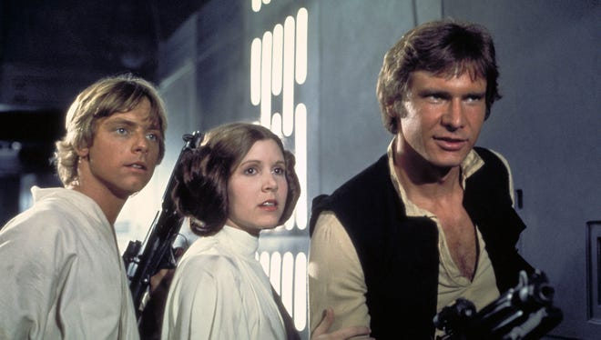 Mark Hamill as Luke Skywalker, Carrie Fisher as Princess Leia and Harrison Ford as Han Solo in a scene from 'Star Wars Episode IV: A New Hope' in 2004.