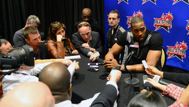 Los Angeles Lakers center Dwight Howard talks to reporters at the NBA All-Star weekend in Houston.