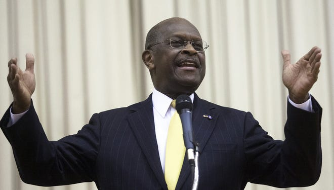 Herman Cain speaks on Nov. 28 at the University of Texas of the Permian Basin in Odessa.