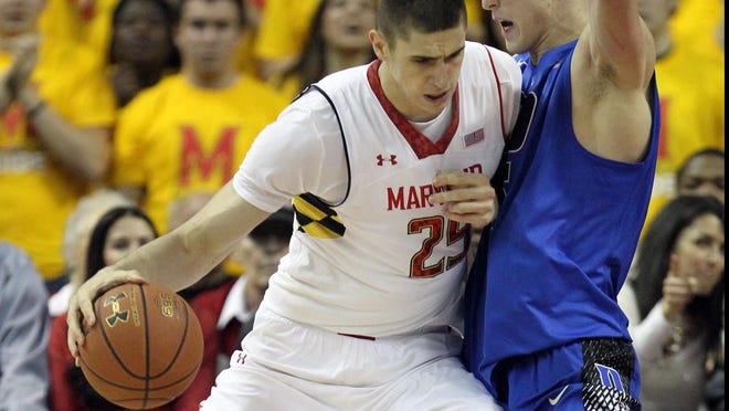 Duke forward Mason Plumlee (5) defends against Maryland center Alex Len (25) on Saturday in an ACC matchup in College Park, Md. The Terrapins defeated the top-ranked Blue Devils 83-81. Len had 19 points, nine rebounds and three shot blocks in the win.