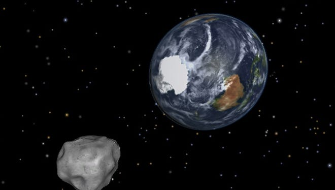 This image shows a simulation of asteroid 2012 DA14 approaching from the south as it passed through the Earth-moon system on Friday, Feb. 15, 2013. The 150-foot object will pass within 17,000 miles of the Earth.