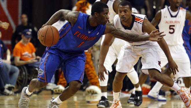 Florida guard Kenny Boynton (3) runs a play as Auburn guard Brian Greene (24) defends during the second half Saturday in Auburn, Ala. Boynton and the Gators are the SEC's best men's basketball team this season, and it doesn't appear close.