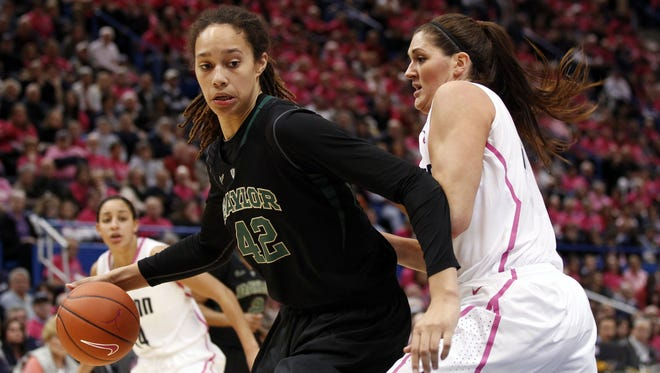 Baylor Bears center Brittney Griner (42) works the ball against Connecticut Huskies center Stefanie Dolson (31) during the second half at the XL Center.