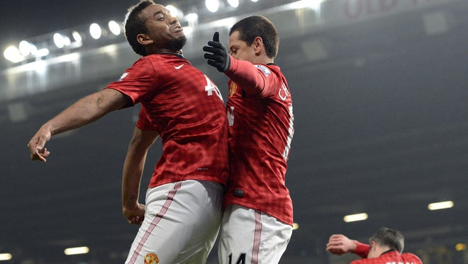 Manchester United striker Javier Hernandez celebrates with Brazilian midfielder Anderson after scoring a goal. Manchester United topped Reading 2-1 to reach the FA Cup quarterfinals.