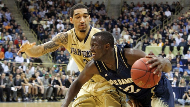 Notre Dame Fighting Irish guard Jerian Grant (22) drives to the basket against Pittsburgh Panthers guard Cameron Wright (3) during the first half at the Petersen Events Center.