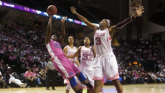 Kentucky center Samarie Walker (23) shoots against Texas A&M center Kelsey Bone (3) and guard Adrienne Pratcher (32) during the second half of an NCAA college basketball game.