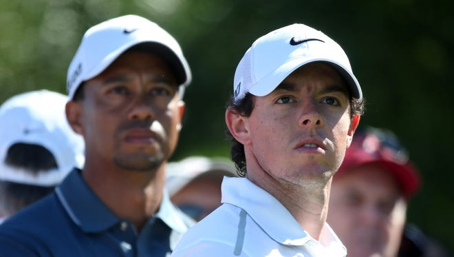 Rory McIlroy of Northern Ireland (R) and Tiger Woods of the USA are the No. 1 and No. 2 seeds at the WGC-Accenture Match Play Championship.