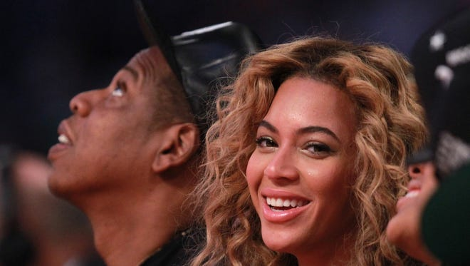 Beyonce and Jay-Z enjoyed the NBA All-Star game at the Toyota Center on Feb. 17 in Houston.