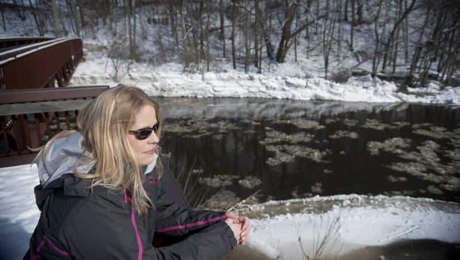 Heather Holland of Big Rapids, Mich., has worked on about 20 missing persons cases and helped solve several of them.